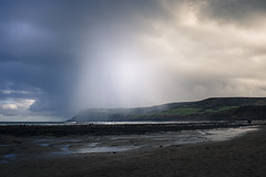 about to get wet (Robin Jaffray) Tags: uk winter storm beach rain clouds squall landscape coast fuji yorkshire north cliffs northsea cloudburst fujix100s x100s