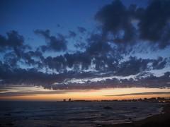 Les Sables d'Olonne (merlaudp) Tags: ocean city sunset sea sky mer france night clouds landscape lights soleil seaside coucher olympus ciel nuages paysage nuit ville lumires vende borddemer