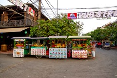 Stalls selling fresh fruit juice, shake and smoothies at Pub Street in Siem Reap, Cambodia (UweBKK ( 77 on )) Tags: road street fruit evening pub asia cambodia kambodscha dusk juice sony fresh siem reap shake southeast alpha dslr angkor smoothie 77 stalls slt