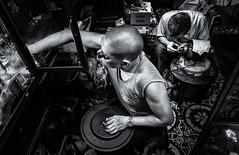Zyklop Watchmaker (Axel Halbgebauer) Tags: street travel portrait people blackandwhite bw zeiss asia watches pov candid sony vietnam workshop worker fe hanoi clocks watchmaker zyklop
