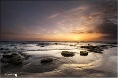 La Barrosa (Caramad) Tags: longexposure light sunset sea espaa seascape marina landscape mar agua rocks playa colores andalucia puestadesol olas rocas wate cadz chiclanadelafrontera oceanoatlantico