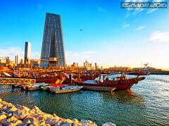 Cityscape by the seaside (Snap) Tags: sea seascape boats fishing scenery cityscape nightscape side nightscene kuwait souq q8 souqsharq sharq q8city