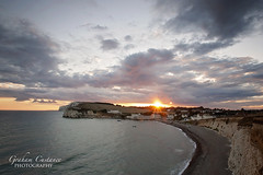 Freshwater Bay Sunset (gracust) Tags: ocean sky seascape beach clouds landscape island sand pebbles cliffs isleofwight serene tranquil freshwater iow freshwaterbay
