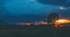 At the end of the day (Mavroudakis Fotis) Tags: sunset sky orange sun sunlight mountain color tree nature beautiful beauty clouds landscape evening twilight colorful glow sundown natural dusk vibrant vivid sunny backlit outline range