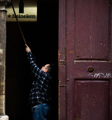 Clearing-Up (prulka) Tags: street old city light shadow urban streetart man guy colors composition contrast work dark heineken photography nikon doors working streetphotography poland cleaning capture simple cracow oldtown lightandshadow oldcity moring simplebeauty contrastive clearingup nikonphotography simplephotography