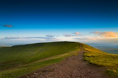 Look carefully and you will see the sheep........ (Eric Goncalves) Tags: uk blue light sky sun mountain lake cold beautiful wales clouds landscape warm view horizon brecon penyfan ericgoncalves