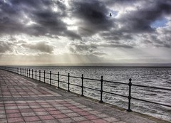 Taking a promenade West Kirby Wirral (cathbooton) Tags: sky lake storm water sunshine wales clouds canon path gull hills promenade rays welsh railings gertrude hdr wirral westkirby 18270mm canoneos550d