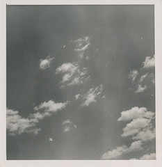 Vintage photo of a lightly clouded sky (simpleinsomnia) Tags: life old sky stilllife cloud white black nature monochrome vintage found blackwhite still antique snapshot photograph vernacular foundphotograph
