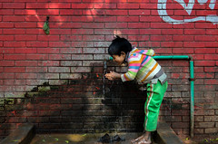 Refreshing.. (ashik mahmud 1847) Tags: boy red color water kid outdoor background joy bangladesh d5100