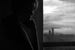 Don't pine for immortality if you don't know what to do with yourself on a rainy day (eweliyi) Tags: light portrait blackandwhite bw woman me window girl monochrome contrast self pose dark mood sitting rainyday melancholy ja project365 82365 eweliyi halflitface 365v4