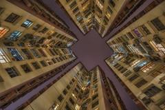 Lookup Hong Kong (reinaroundtheglobe) Tags: china longexposure nightphotography color architecture buildings hongkong nightshot outdoor symmetry lookup quarrybay towardsthesky