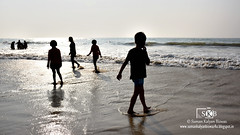 Children Playing on the Beach (Suman Kalyan Biswas) Tags: morning sea india beach nature silhouette kids children fun play outdoor portraiture orissa daybreak touristspot puri bayofbengal watergame  odisha puriseabeach   wavesseabeach autoremovedfrom1to5faves portraitureinmotion indianpopularbeach