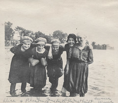 Group of women standing in the water (simpleinsomnia) Tags: old woman white black water monochrome smiling vintage found blackwhite antique snapshot off photograph goofingoff vernacular swimmers goofing foundphotograph floater