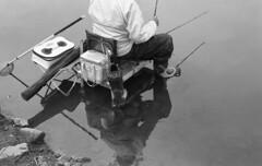 Angler (odeleapple) Tags: bw film 50mm fishing pond nikon f100 af nikkor angler f18d neopan100acros