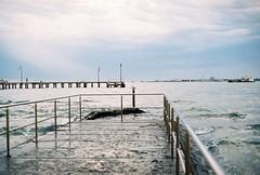 In gloom. (nikki.lake) Tags: ocean sky film beach port pier boat melbourne gloom canonae1