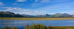 The Snowdonian Range (the_anachronist) Tags: blue sky sun colour green water yellow wales clouds landscape nikon sunny wideangle hills snowdon nikkor snowdonia porthmadog f3556g 18105mm d7100