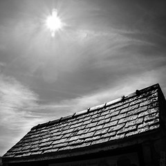 Sun_Roof. (PJT.) Tags: roof sky cloud sun wales point glare apex flare warren slate angled llanddwyn newborough anglessey