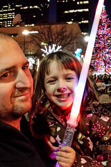 Fun at the Christmas Parade (Vegan Butterfly) Tags: christmas family light people girl daddy toy kid dad edmonton child father daughter parade event together saber sword