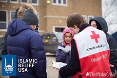 Islamic Relief USA works with the American Red Cross to distribute water bottles to the residents of Flint, MI.