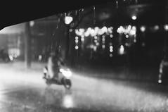Rainy night (Georgi C) Tags: street blackandwhite blur streets monochrome rain bike night lights driving nightshot bokeh sony voigtlander streetphotography rainy citylights motorcycle raindrops nokton nex5r sonynex5r voigtlandernoktonclassicf14