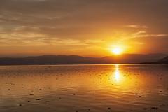 Mexican Sunset (Eunice Gibb) Tags: sunset lake mexico sundown jalisco sierra ajijic axixic lakechapala mexicansunset sunsetoverwater mexicanlake lakeinmexico ajijicsunset lakechapalasunset sierradesanjuancosala