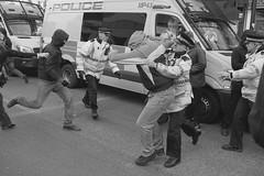 Lime Street Scuffle (the underlord) Tags: street slr film liverpool protest streetphotography police nikonf100 demonstration vehicle streetphoto van limestreet antifascist merseyside ilfordfp4 kodakd76 nikkor35afd