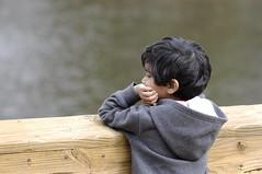 Deep thoughts (Filsa Bint Ahmed) Tags: park family lake cold hair walking virginia kid afternoon child 4 son richmond thoughts messy boardwalk years abid cloudyday playarea d90 deeprunpark sooc nikon70200mmf28g