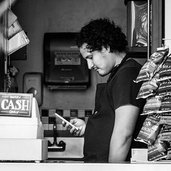 Sorry... Cash Only (dharder9475) Tags: blackandwhite bw man square store market candid streetphotography pikeplacemarket seattletrip 2015 socialphotography lookingatphone privpublic