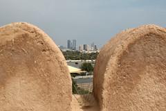 View from the castle... (John Konstandis) Tags: sky tower castle stone skyscraper view fort uae emirates unitedarabemirates fujairah emiratetowers canonef24105mmf4lisusm canoneos5dmarkiii