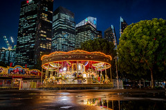 Merry Go Round (edfy) Tags: sunset moon holiday tourism work fun singapore play go fair center round merry financial