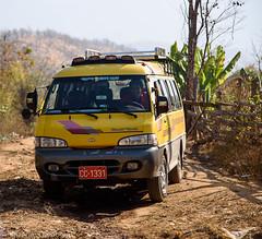 Mr Myoe in his car (JohannesLundberg) Tags: people expedition yellow person burma peoples myanmar persons minibus caver speleologist myoelwin