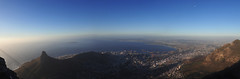 At the top of the world (enora.mebrouk) Tags: world voyage africa city travel blue light sunset sky panorama moon nature montagne lune landscape southafrica photography photo heaven photographie view lumire top picture bluesky olympus capetown hike ciel summit paysage moutain ville afrique atthetop hybride tablemoutain