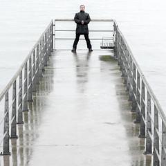 Stand in Rain (Hkan Dahlstrm) Tags: sea people man rain photography se pier skne sweden cropped f71 helsingborg resund 2016 skneln xe2 sek strandvgen40 xf1855mmf284rlmois 1505042016160749