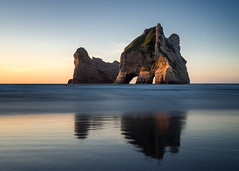 Archway Islands sunset (loveexploring) Tags: longexposure sunset sea seascape reflection beach landscape island arch pacificocean southisland tasmansea westcoast seastack rockarch whararikibeach