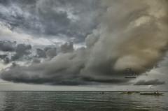 Only in Iloilo, Philippines. (danmocs) Tags: sea sky cloud water boat fisherman iloilo