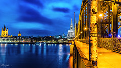 Cologne @ night (ColognePhotograph) Tags: city bridge blue sky water architecture night river photography gold photo wasser cathedral nacht dom cologne himmel kln stadt architektur blau brcke rhein photoart nordrheinwestfalen hohenzollernbrcke bezaubernd colognephotograph