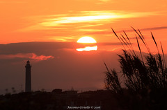 Magia al faro (Antonio Ciriello) Tags: sunset italy sun lighthouse canon italia tramonto colours sole tamron 70 colori puglia taranto 70300 apulia sanvito fato 600d caposanvito 70300vc eos600d canoneos600d tamron70300vc rebelt3i 70300vcusd