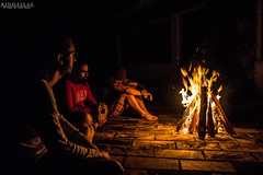 Contemplating (Kindallas) Tags: light vacation night canon fire cool looking floor outdoor guys bonfire t5 firewood relex lual