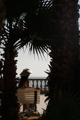 Natali Antonovich (Natali Antonovich) Tags: nature water hat seaside spain hats lifestyle catalonia palm relaxation seashore sitges mediterraneansea seasideresort seaboard balearicsea nataliantonovich iberiansea