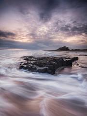 Bamburgh Castle (Squareburn) Tags: longexposure castle sunrise coast northumberland bamburgh bamburghcastle waternovement