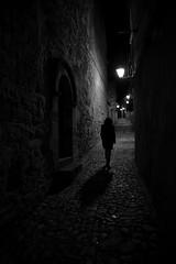 (cherco) Tags: street light shadow woman luz silhouette stone night composition canon noche calle puerta gate alone floor negro sombra nocturna lonely lantern silueta farol solitary nocturne solitario suelo composicion adoquinado aloner