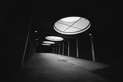 March of the (Gi)ants - Explored (Panda1339) Tags: uk light blackandwhite abstract london art architecture bug tunnel barbican