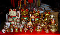 0340 Chinatown, Kuala Lumpur, Malaysia (Traveling Man  Traveling, back soon) Tags: city red urban white black colors shop scarf cat ceramic table asian gold store paw asia southeastasia chinatown forsale bell capital bib malaysia calico kualalumpur collar figurine manekineko beckoningcat federal sculptures metropolitan malay japanesebobtail goodluck talisman luckycat happycat fortunecat luckycharm neckerchief southernmostpoint  welcomingcat moneycat chineseluckycat tanjungpiai peninsularmalaysia canonef24105mmf4lisusm constitutionalmonarchy globalcity alphaworldcity federalterritoryofkualalumpur canoneos5dmarkiii markaveritt new7wonderscities greaterkualalumpur continentaleurasia