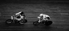 Derny race (I) (pix-4-2-day) Tags: frank schwarz pacer germany andreas graf rider austria derny european bicycle racing bike helmet velodrome hannover wülfel race schwarzweis sport österreich radrennfahrer radrennen 1 bahn radrennbahn pix42day