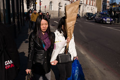 Coming back from the flower market (Gary Kinsman) Tags: ec1 shoreditch oldstreet streetphotography streetlife candid shadows 2016 fujix100t fujifilmx100t flowers bright london eastlondon eastend sunday sun shield people person