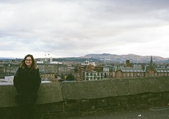op - chloe at the castle walls (johnnytakespictures) Tags: city woman cute castle film girl smile smiling yard pen glasses scotland lomo lomography edinburgh pretty cityscape photographer view horizon chloe olympus walls analogue halfframe ee3 chloelee lomographycn400