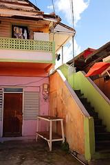 Caribbean Colors 15 (Dieter Drescher) Tags: door pink blue red sky orange house rot colors clouds colours limegreen balcony balkon eingang entrance rosa himmel wolken haus stairway diagonal treppe caribbean railing blau tr farben gelnder karibik lindgrn pastelgreen karibisch dieterdrescher