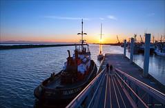 Island Sentries (Clayton Perry Photoworks) Tags: sunset people canada vancouver boats spring couple bc richmond richmondbc stevestonfishingvillage explorebc explorecanada