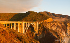 Bixby Bridge at Sunset (Raph/D) Tags: ocean voyage california road ca trip travel bridge sunset usa west building colors beautiful rock architecture america canon eos one 1 golden coast us big highway warm place state pacific united scenic calif cal american shore 7d pont l sur series states catchy tone bixby lightroom lseries canoneos7d