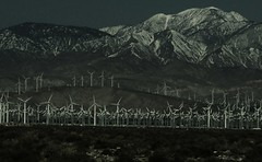 On the road into Palm Springs (Renee Rendler-Kaplan) Tags: california road travel bw mountains night dark evening highway scenery darkness kodak 10 palmsprings roadtrip ten moonlight coachella palmspringscalifornia windfarm windturbines laist reneerendlerkaplan californiadreamingfreeway